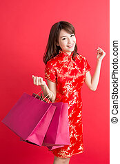 beauty woman wear cheongsam and take shopping bag in chinese...