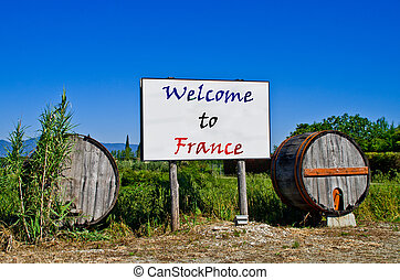 Billboard with barrels says Welcome in France
