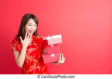 beauty woman wear cheongsam and show gift box to you in...