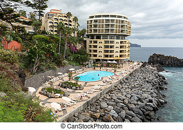 Swimming pool with tourists at Lido hotels zone in Funchal,...