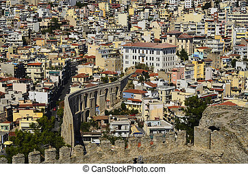 Greece, Kavala, ancient aqueduct Kamares and buildings in...