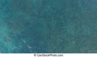 Aerial shot of blue ocean surface and foamy waves - Aerial...