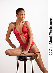 Creole ethnic woman in red one piece swimsuit