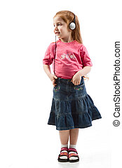 Young girl listening to music in head phones