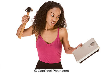 Ethnic woman frustrated by results of her diet - Young...