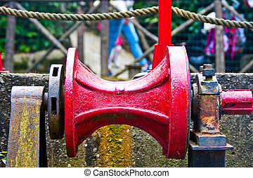 pulley red metal with rust - old and rusty gear pulley of a...