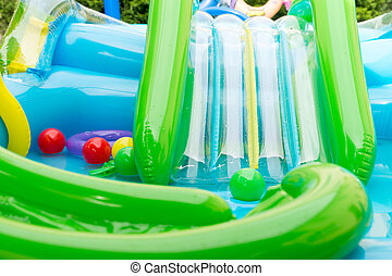 Childrens wading pool with water slide