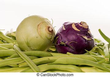 green Beans and Kohlrabi - many freshly harvested green...