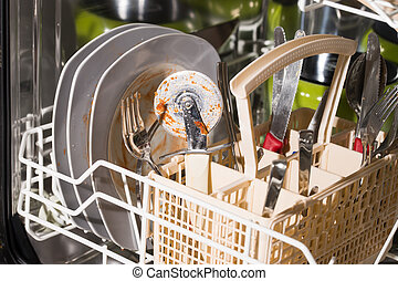 dirty dishes and cutlery in a dishwasher