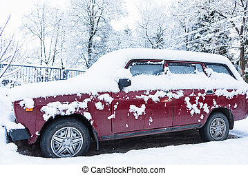 tunes snow cars - car is parked tunes with thick layer of...