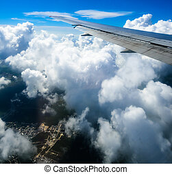 view of the wing of an airplane through the window - view of...