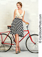 retro styled lady - Romantic summer girl with her bicycle....