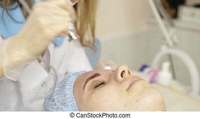 Diamond microdermabrasion, peeling treatment at cosmetic beauty spa clinic. woman getting a vacuum microdermabrasion procedure