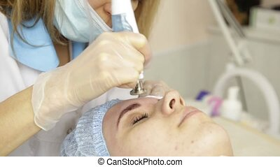 Diamond microdermabrasion, peeling treatment at cosmetic...