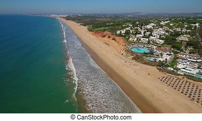 Aerial. Beaches and the coast, tourist town Vale de Lobo....