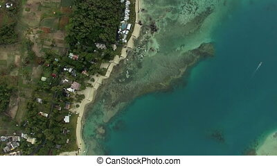 Aerial bird eye view of coast with sand beach and transparent water of Indian Ocean, Mauriticus Island
