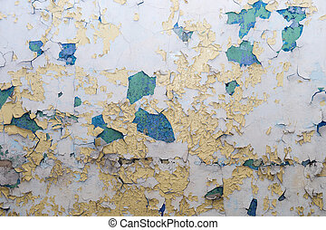 Old paint peeling from a wall