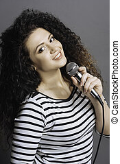 Portrait of happy looking girl holding microphone - It is my...