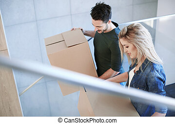 Cheerful couple moving into new flat