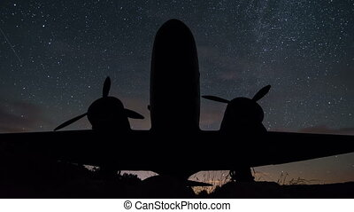 Stars sky turning over vintage military aircraft time lapse. Night sky with milky way galaxy