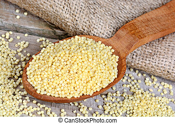 Millet seeds on table
