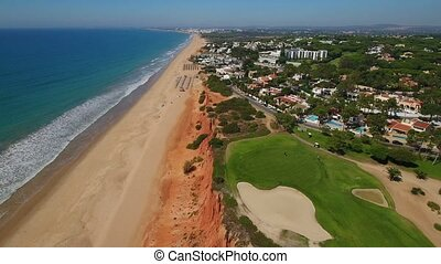 aerial. Green golf courses and beaches Vale de Lobo. Algarve...