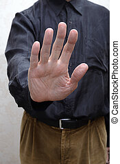 Man With Open Hand to Say Stop to Corruption - A man saying...