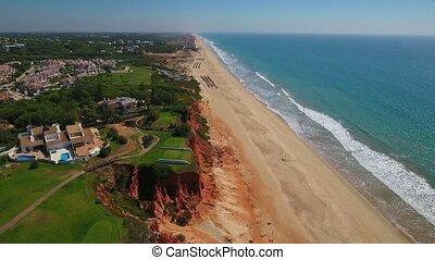 Aerial. Sandy beaches golf courses Vale de Lobo. Portugal