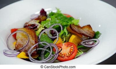 watering salad oil