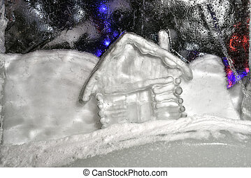 Snowy house in a block of ice