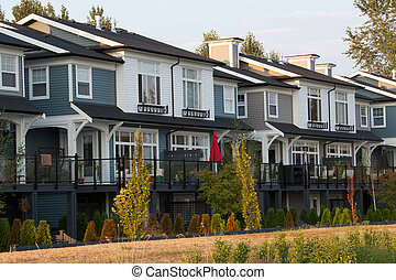 Upscale townhouses backing onto large yards - Several large...