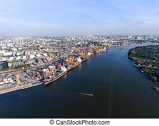 Aerial shot of large bangkok shipping port taken in afternoon