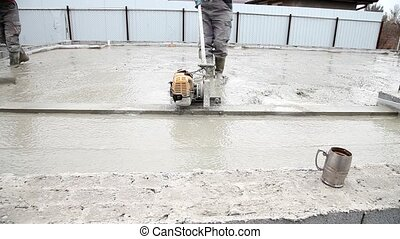 Pouring concrete mix from cement mixer on concreting