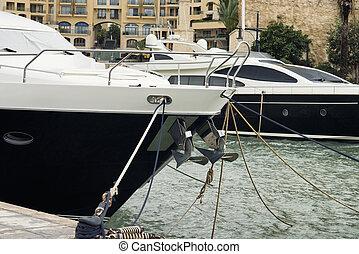 Super yachts moored at Portomaso, Malta