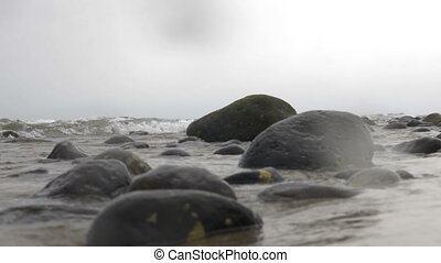 Sea waves washing rocks - Sea waves rolling in and washing...