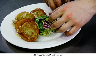 serving of potato pancakes on a plate.