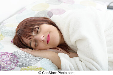beautiful young woman sleeping on her bed