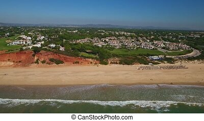 Aerial. Beach Garrao shores Vale de Lobo filmed from the...