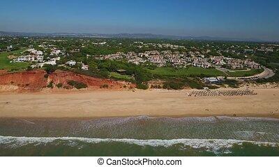 Aerial. Beach Garrao shores Vale de Lobo filmed from the...