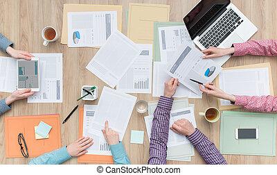 Business teamwork - Business team working at office desk...