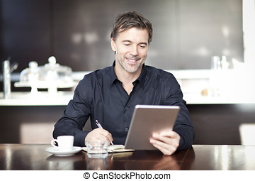Handsome Man Writing At The Coffee Shop. Using Computer. -...