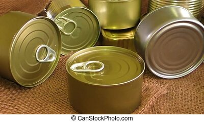 Closed metal tin cans on brown background