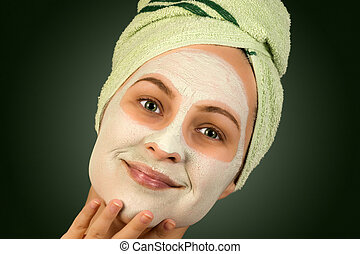 face mask skincare - Portrait of woman with face mask and...