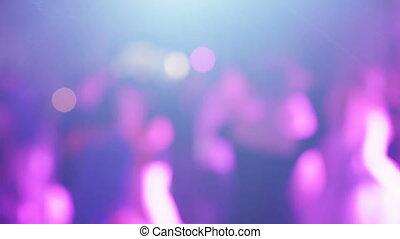 Bokeh of dancing people - In Rasfokus people dancing on...