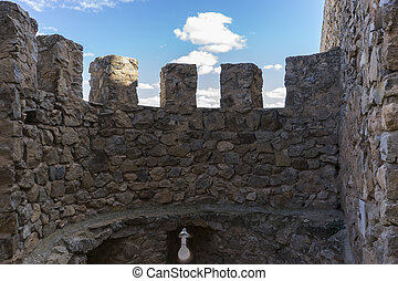 Stone walls of a medieval castle. Town of Consuegra in the...