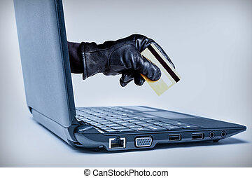 Cyber Crime Concept - A gloved hand reaching out through a...