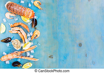 Fresh seafood on blue background - Fresh seafood border with...