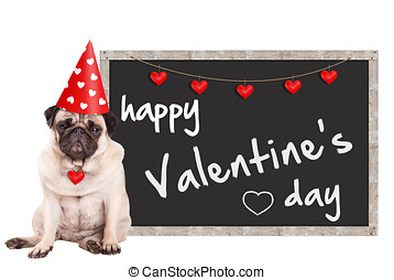 lovely pug puppy dog wearing party hat with hearts, sitting...