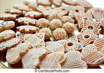 Biscuit cake and coconut balls in natural light