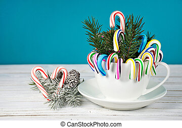 candy cane and pine bouquet in white coffee cup with heart...